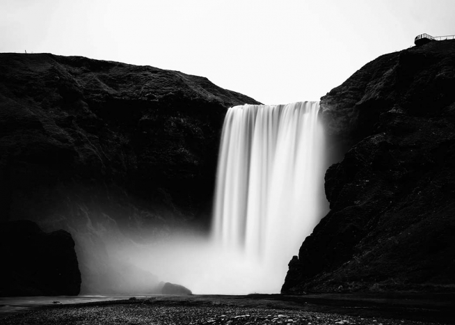 - Black and white landscape shot of Icelandic waterfall Skógafoss