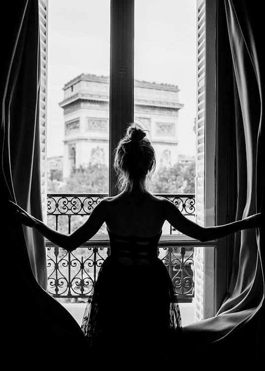 – Black and white photograph of a woman in a window with the Arc de Triomphe in the background