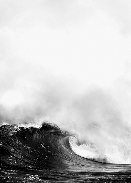 – Black and white photograph of a large ocean wave