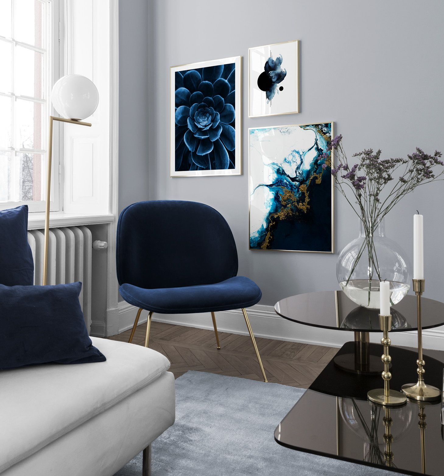 Blue interior living room – abstract posters and chair from Gubi