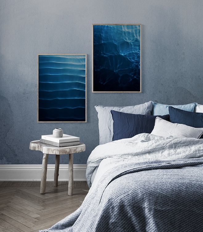 Blue bedroom with dark blue poster pair
