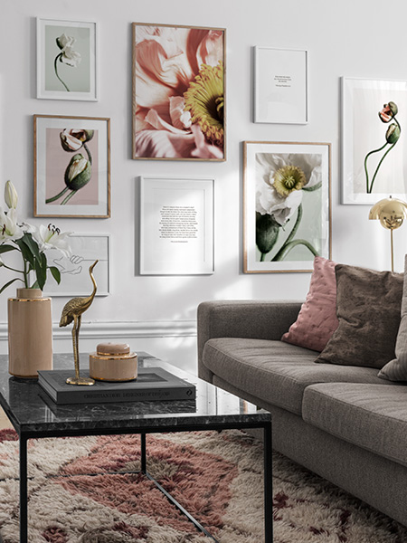 Floral posters from Desenio. Wall with framed posters of flowers and other plants.